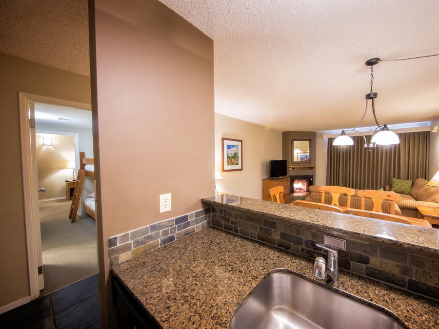 Tantalus-Bunk-suite-living-room-hall-kitchen-view